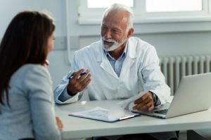 Doctor discussing finance with patient