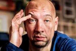 Drowsy man holding eye open